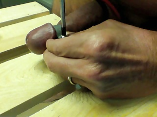 Men (Gay) Cock head in pillory for wax treatment